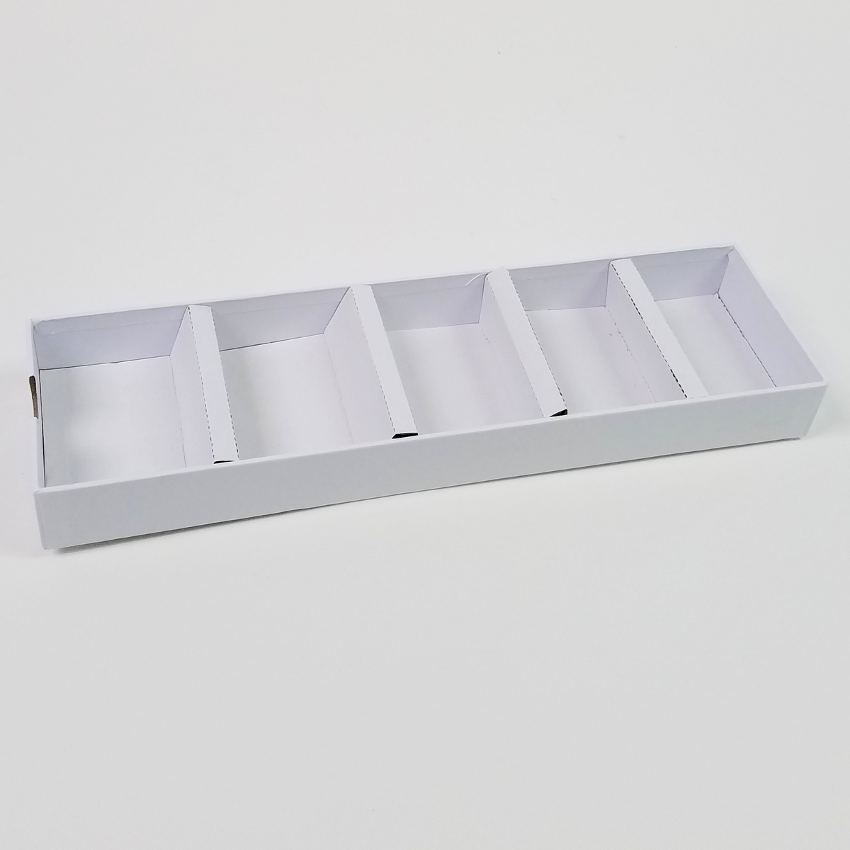 Drawers are like trays, and can be removed.