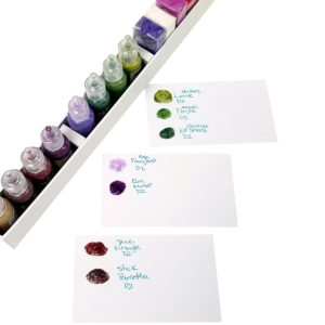 Organize scrapbooking supplies with Totally-Tiffany, glitter glue and inks