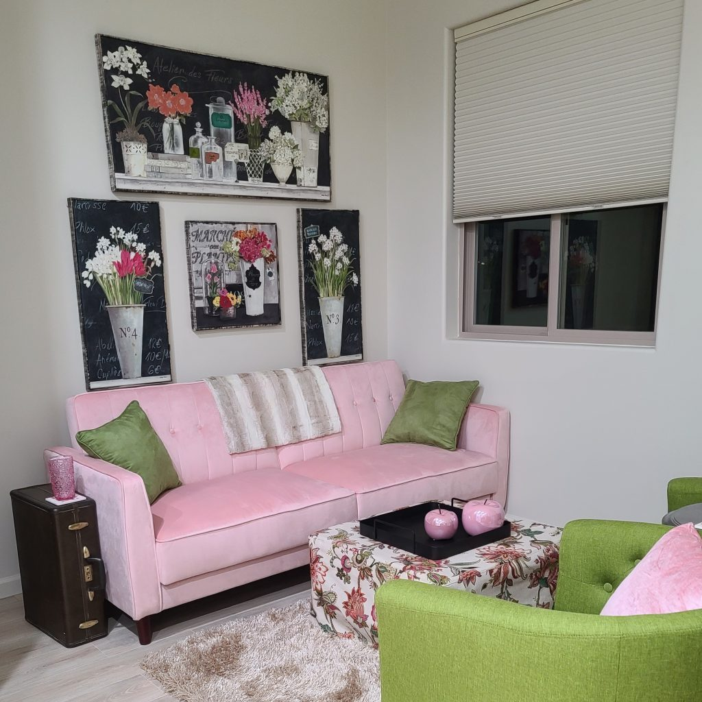 custom home decor hanging on wall with pink couch