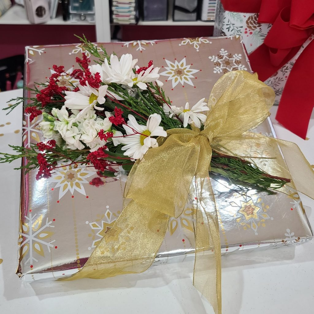 wrapped gift with flowers on top
