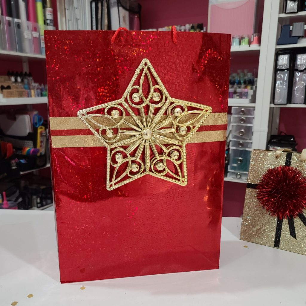 gift bag with star tree topper